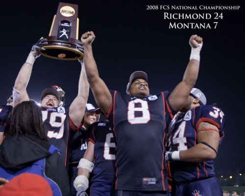 Hoisting the NCAA Division 1 FCS Championship Trophy